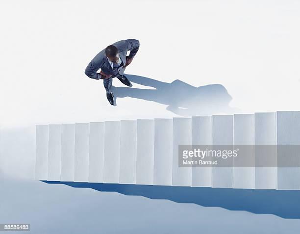 Businessman looking at stairway