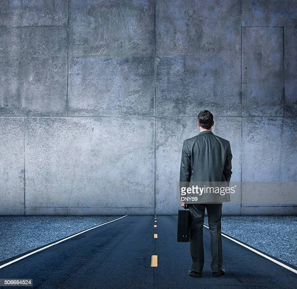 Businessman Looking At The End Of The Road