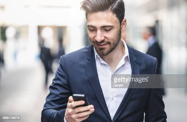 Businessman Looking at the Mobile Phone