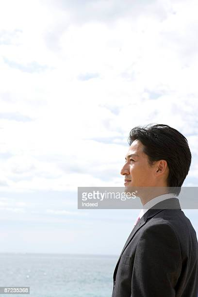 Businessman looking at view