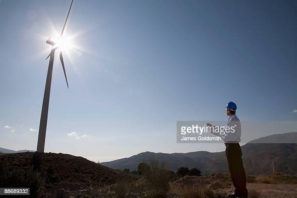 Businessman looking at wind turbine