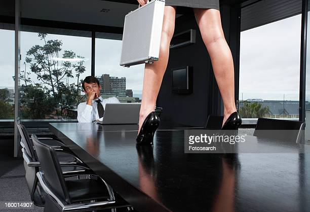 businessman looking at woman's legs - man touching womans leg stock photos and pictures