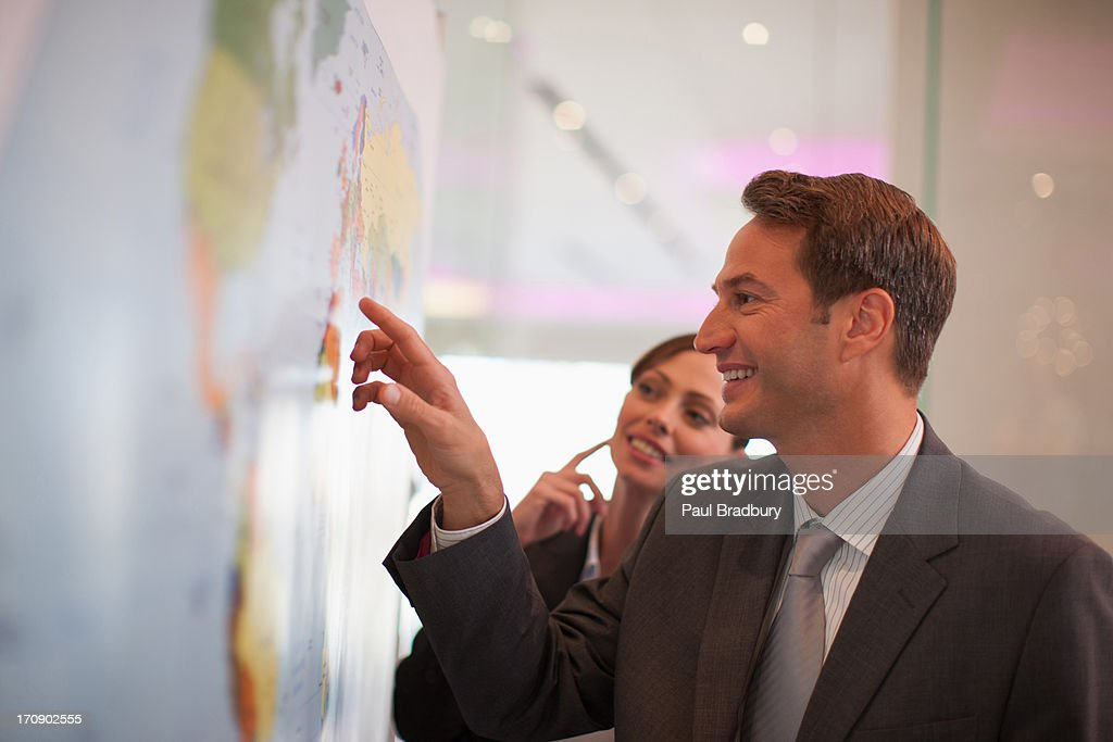 Businessman looking at world map : Stock Photo