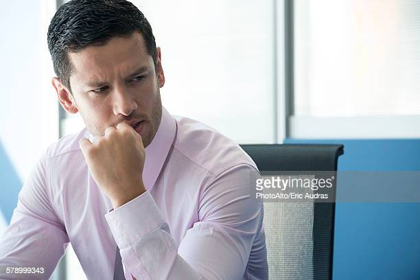 Businessman looking away concerned