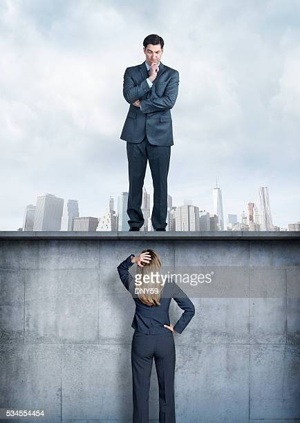Businessman Looking Down At Businesswoman