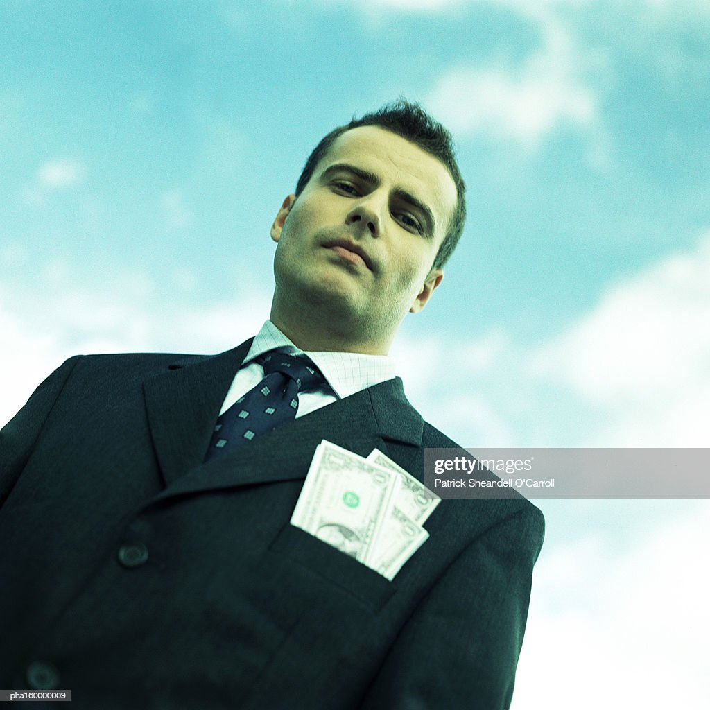 Businessman looking down into camera, low angle view, portrait. : Foto de stock