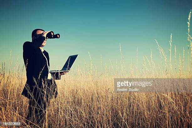 businessman looking field for investment. - surveillance stock pictures, royalty-free photos & images