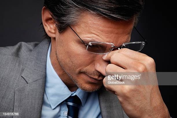 Businessman looking frustrated