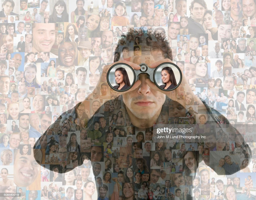 Businessman looking in binoculars over montage of smiling faces : Stock Photo