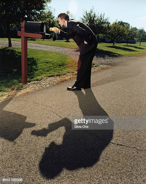 businessman looking in mailbox - domestic mailbox stock pictures, royalty-free photos & images