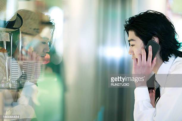 businessman looking in shop window