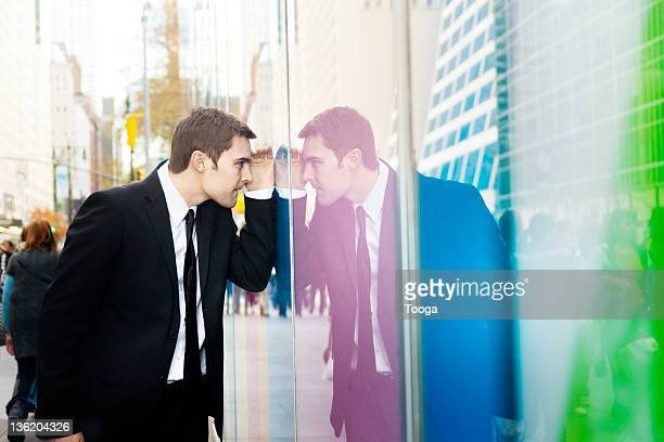 Businessman looking in window