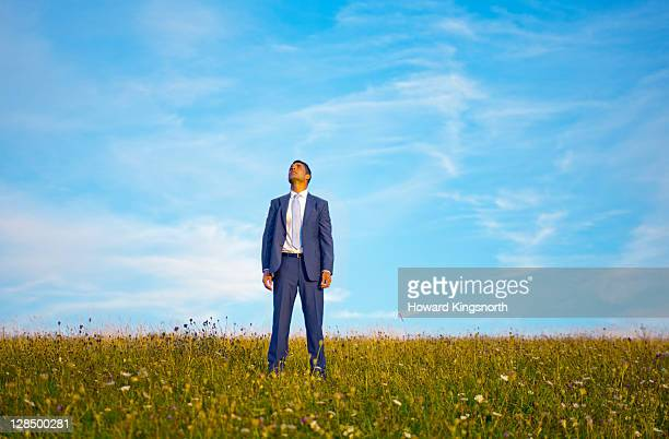 businessman looking into the sky