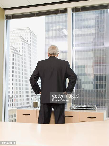 Businessman Looking Out a Window