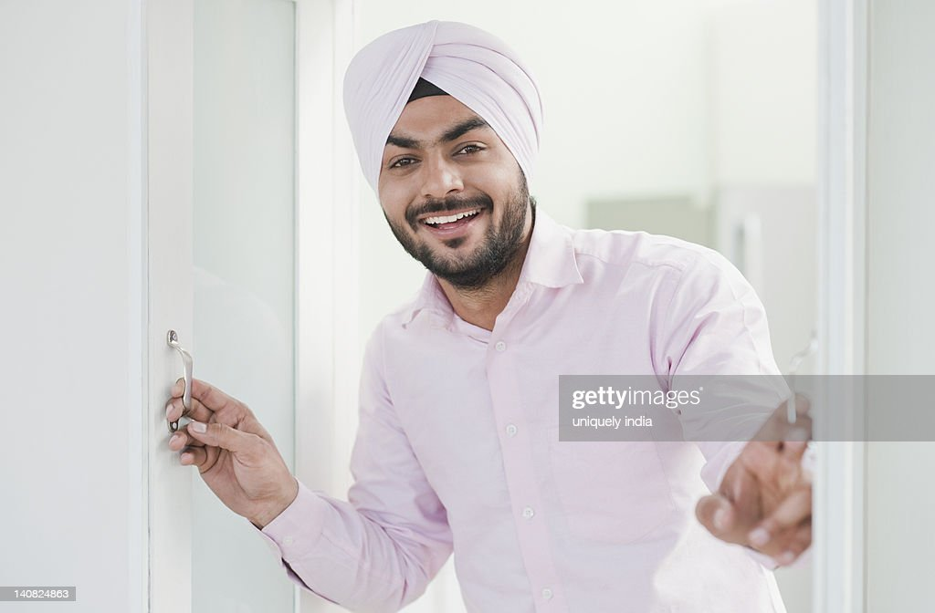 Businessman looking out of a window and smiling