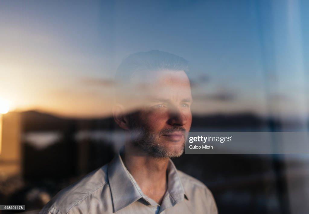 Businessman looking out of a window. : Foto de stock