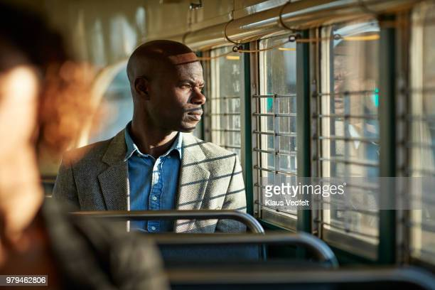 Businessman looking out of the window of tram in San Francisco