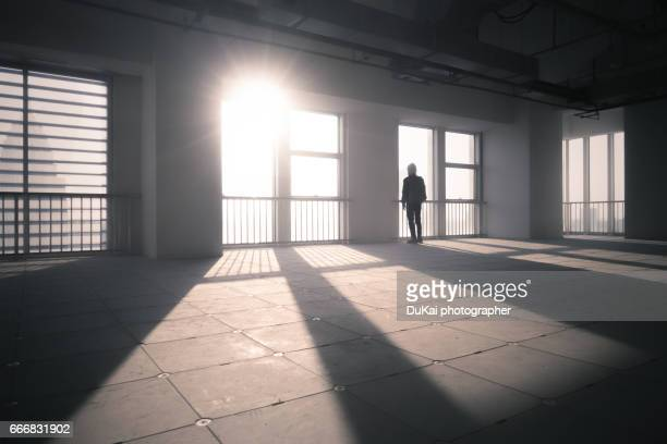businessman looking out of window - vanguardians stock pictures, royalty-free photos & images