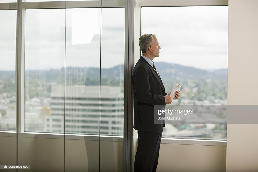 Businessman looking out of window : Foto stock