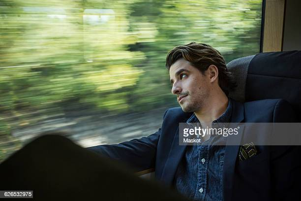 Businessman looking out through train window
