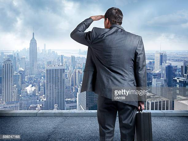 Businessman looking out towards the big city