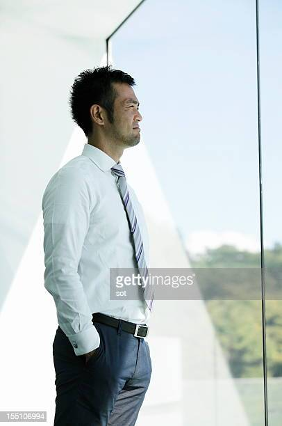Businessman looking out window in office