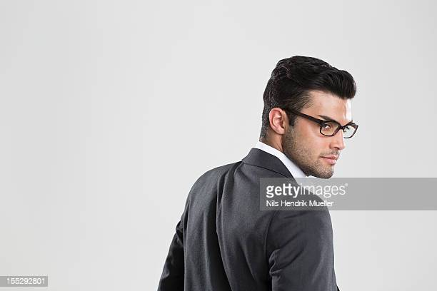 Businessman looking over his shoulder