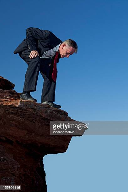 Businessman Looking Over The Edge