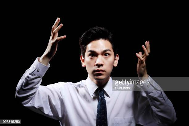 businessman looking surprised, close up, portrait - ショック ストックフォトと画像
