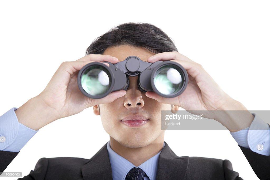 Geschäftsmann Blick durch das Fernglas : Stock-Foto