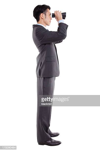 双眼鏡を探しているビジネスマン