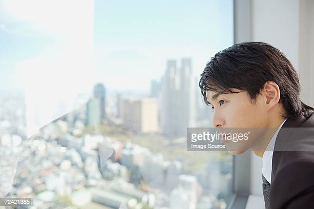 businessman looking through window - only japanese stock pictures, royalty-free photos & images