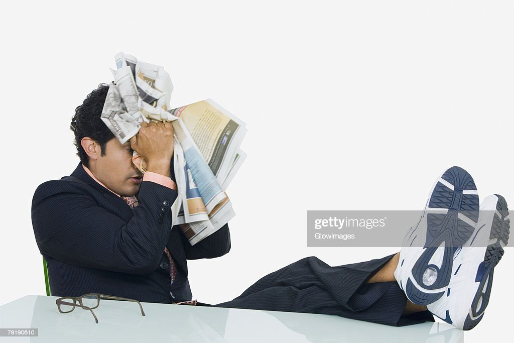 Businessman looking tired : Stock Photo