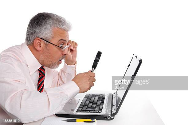 Businessman looking to laptop
