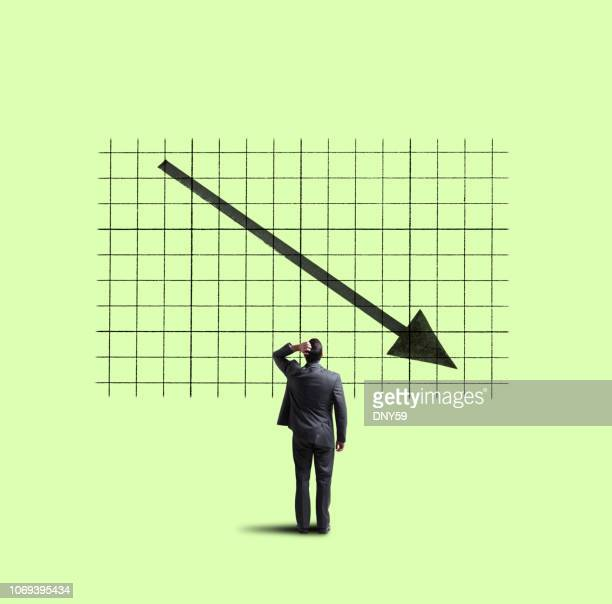 businessman looking up at declining trend - decline stock pictures, royalty-free photos & images