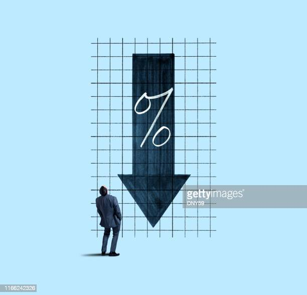 businessman looking up at falling interest rates - interest rate stock pictures, royalty-free photos & images