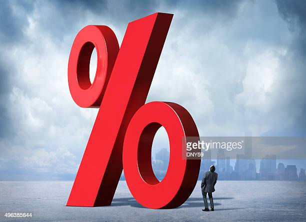 Businessman Looking Up At Percent Sign