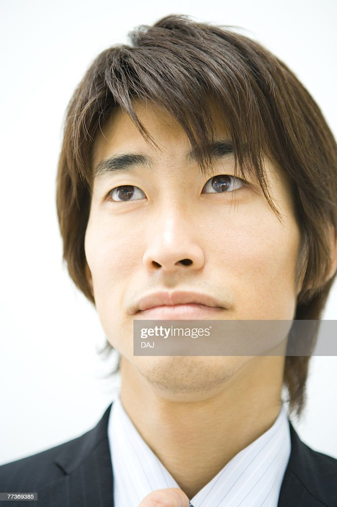 Businessman Looking Up, Front View, Head and Shoulder, Close Up : Photo