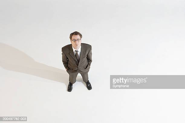 Businessman looking upwards, elevated view