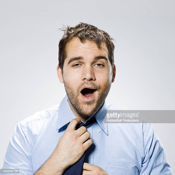 businessman looking very disheveled - yawning stock pictures, royalty-free photos & images