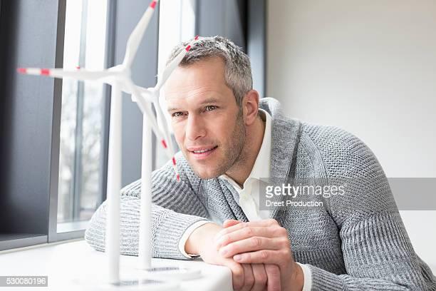 Businessman looking wind turbine