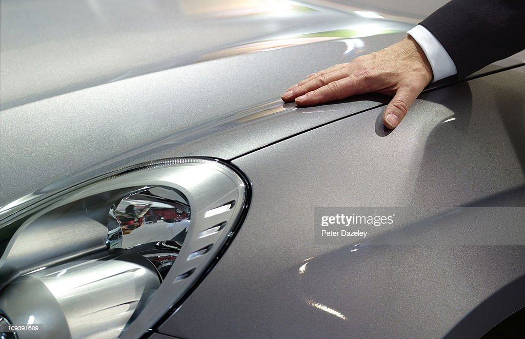Businessman loves his car : Bildbanksbilder