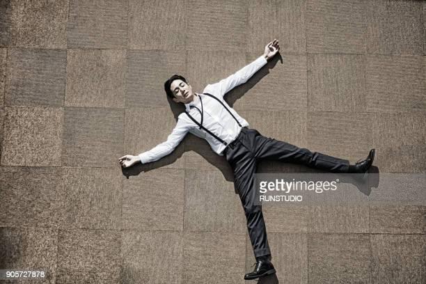 Businessman lying on floor