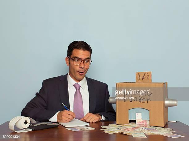 Businessman Makes Money with Homemade Money Machine