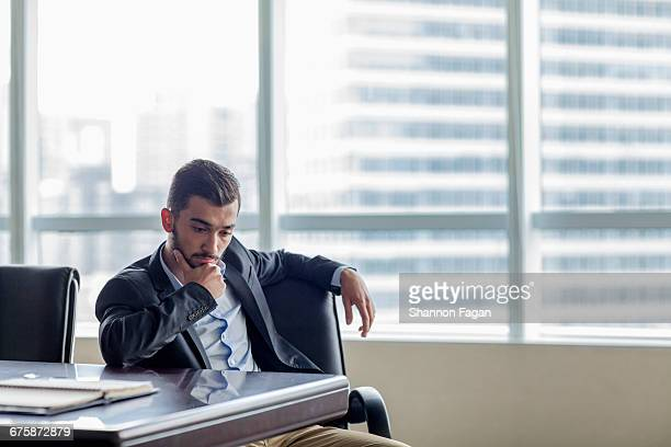 Businessman making decision in conference room