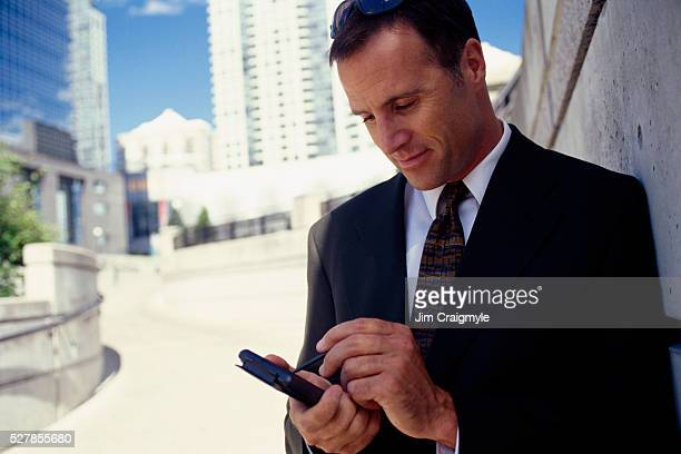 businessman making electronic notes - jim craigmyle stock pictures, royalty-free photos & images