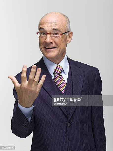 Businessman making hand gesture, portrait