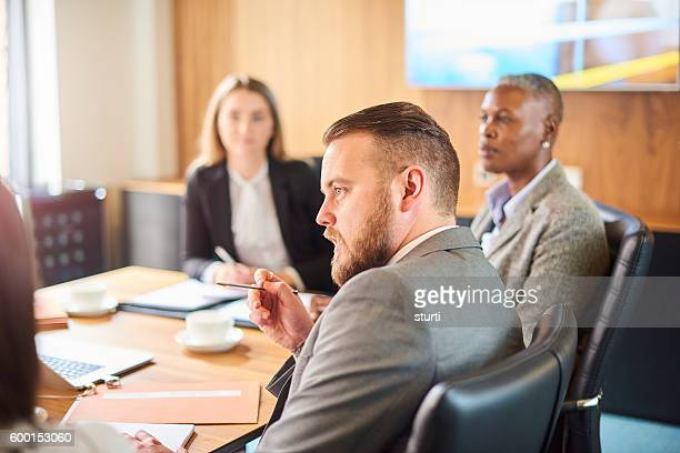 businessman making his point - employment law stock photos and pictures