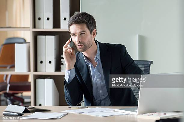 Businessman making important phone call