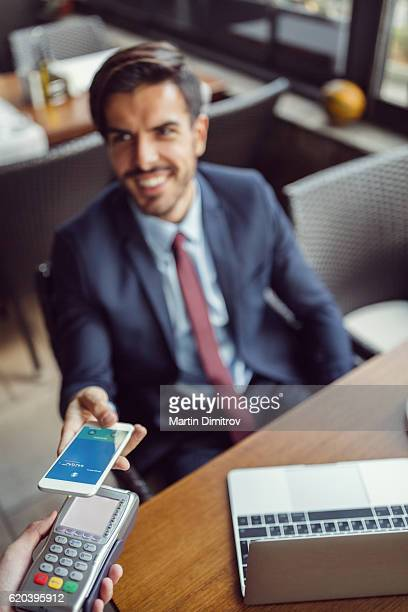 Businessman making mobile payment
